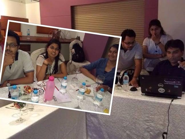 tech team in quarterly meeting
